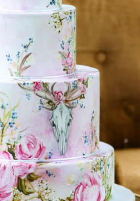 hand painted stag cones and blooms wedding cake